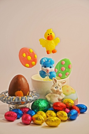 Colourful lollies and chocolate Easter eggs Stock Photo