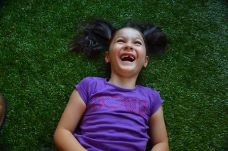 an outburst: Little girl with outburst of laughter