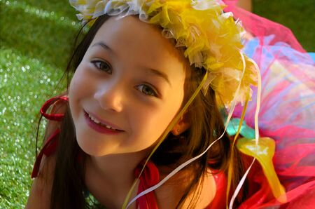 A pretty little girl dressed up as fairy flower photo