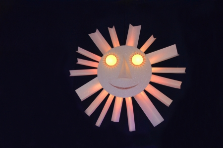 The smiley sun made of paper on black background Stock Photo - 17212101