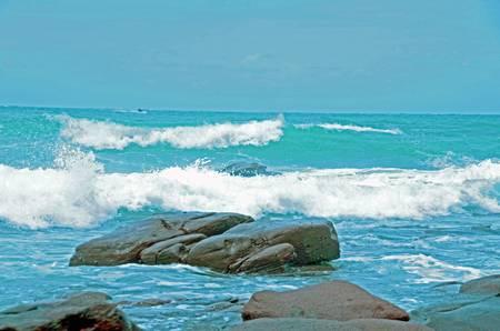 stoney: Big surf heading for the rocks Stock Photo