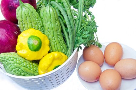 parsley digestion: Healthy food; mixed vegetables in a small basket and eggs
