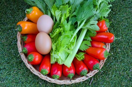 Healthy food; mixed vegetables and eggs in a basket