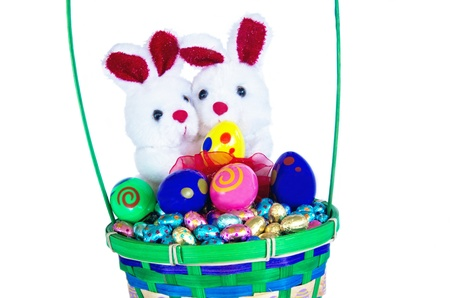 Easter bunny and easter eggs in a basket photo