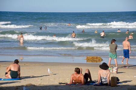 Tourists enjoying the beach,Coolum,Sunshine Coast Editorial