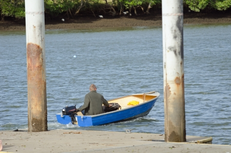 A man is driving a tinny ; Nudgee beach Stock Photo - 20329761