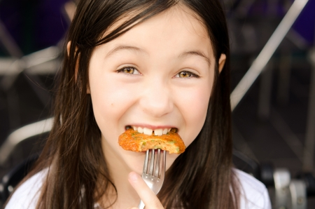 cutie: A cutie girl is eating fish cake  Stock Photo