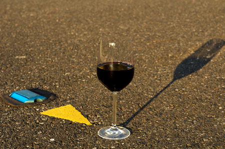 A glass of wine in the middle of the road Stock Photo - 23653675