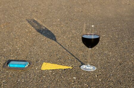A glass of wine in the middle of the road Stock Photo - 23653677