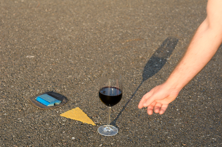 wine road: Reaching for the glass of wine in the middle of the road Stock Photo