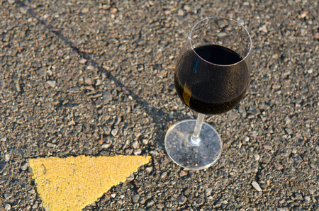 wine road: A glass of wine in the middle of the road