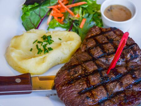 side salad: Rump steak, and mashed potatoes with side salad
