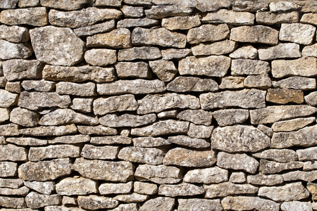 Stone wall background Фото со стока