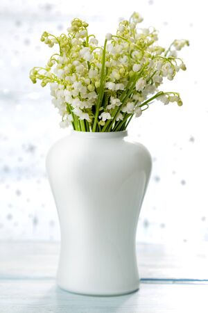 flower bouquet: Lilies of the valley on the table Stock Photo