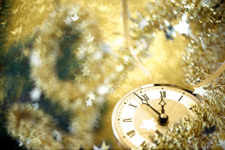 end of the year: Happy New Year. Old clock on yellow abstract background Stock Photo