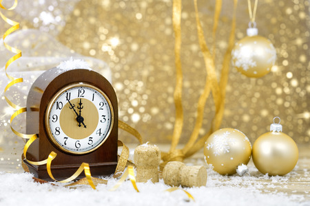 12 hour: Happy New Year. Old clock on yellow abstract background Stock Photo