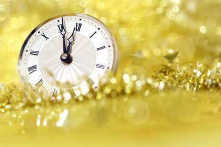 time to shine: Happy New Year. Old clock on yellow abstract background Stock Photo