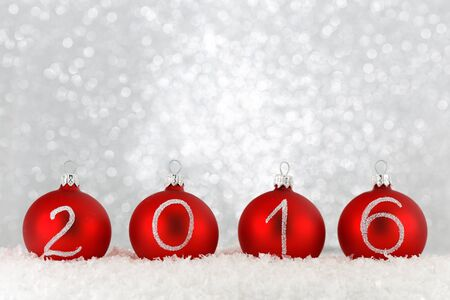 New year 2016 text on christmas baubles Stock Photo