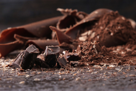 chocolate sweet: Dark chocolate shavings and sprinkled cocoa powder Stock Photo