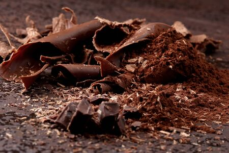 Dark chocolate shavings and sprinkled cocoa powder Фото со стока