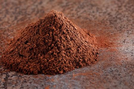 dark brown: Cocoa powder on a stone table Stock Photo