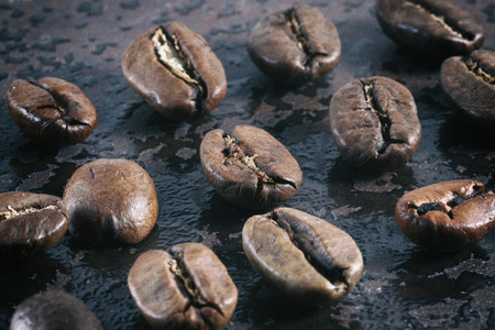 Vintage photo of coffee beans on a stone background