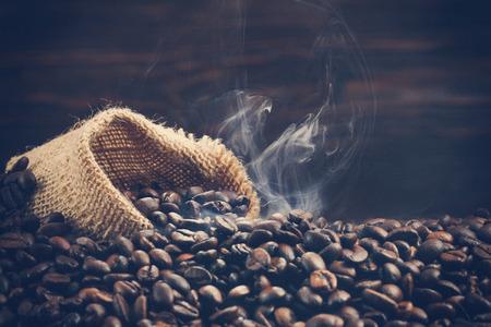 Vintage photo of roasting coffee beans with smoke Stock Photo