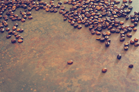 Coffee beans on stone table  coffee background