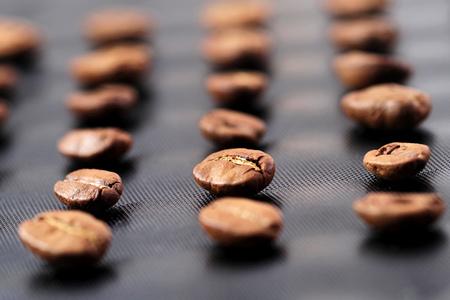 Coffee beans on the dark stone background Stock Photo