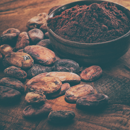 Cocoa powder and coffee beans on a wooden table Reklamní fotografie - 117337433