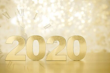 Happy New Year 2020. Symbol from number 2020 on wooden background 免版税图像