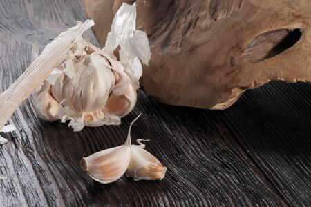 Fresh garlic bulb and garlic cloves on the wooden table
