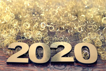 Happy New Year 2020. Symbol from number 2020 on wooden background Фото со стока