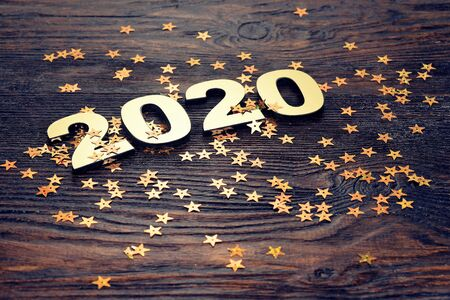 Happy New Year 2020. Symbol from number 2020 on wooden background Foto de archivo - 130857106