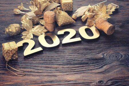 Happy New Year 2020. Symbol from number 2020 on wooden background Foto de archivo - 130857108