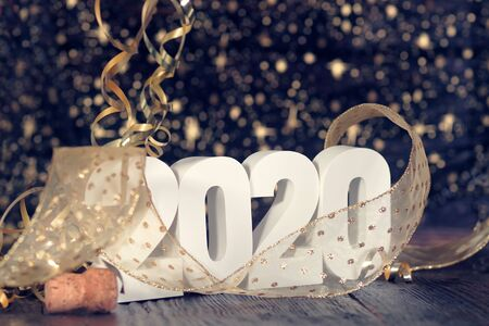 Happy New Year 2020. Symbol from number 2020 on wooden background Foto de archivo - 132542458