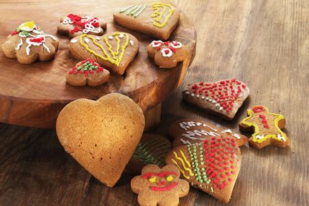 Home made Christmas cookies as a gift for family and friends on wooden table