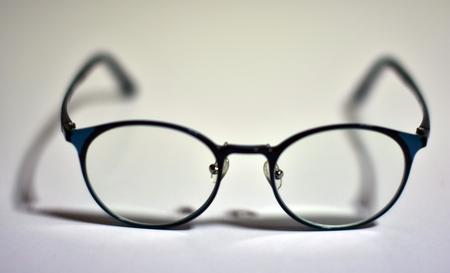 A black-framed reading glasses Фото со стока