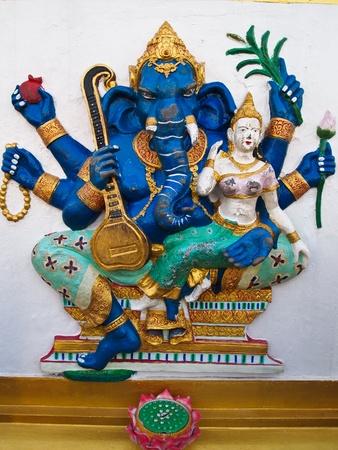 Beautiful ganesha statue on wall at temple, Thailand. photo