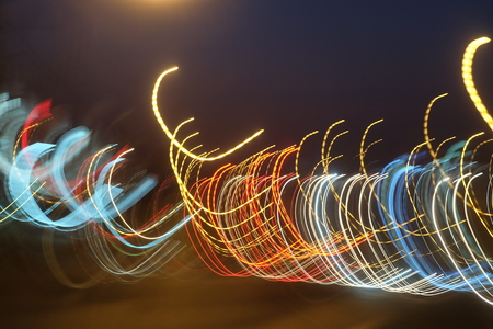 colourful lightings: Traffic lights blurred at night on street