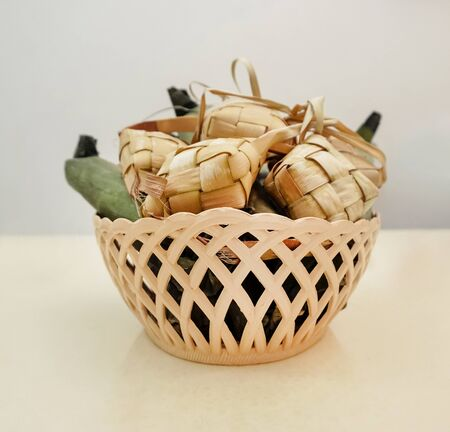 Popular Malay traditional food, Ketupat rice and Lontong Nasi Impit in one basket. Ketupats, a natural rice casing made from young coconut leaves for cooking rice.