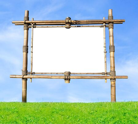 Blank Bamboo Billboard On A Green Hill Over Blue Sky photo