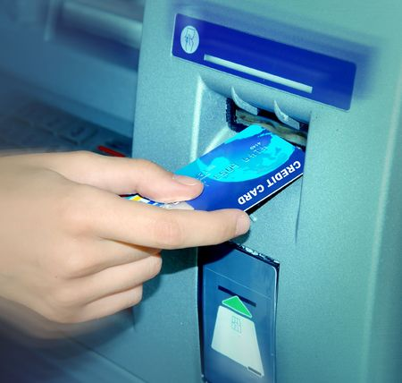 ATM. Inserting A Credit Card. Stock Photo - 587981