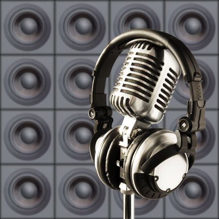 Professional 'Retro' Microphone & DJ Headphones Against The Wall Of Speakers Stock Photo - 587979