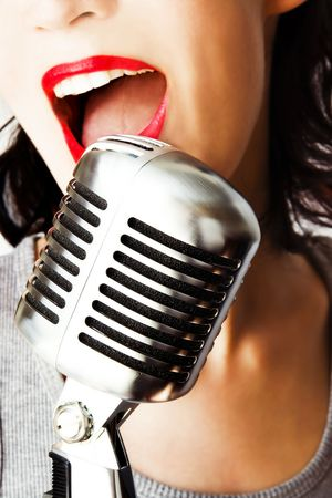 Trendy Singer (Girl Singing In Retro Microphone) photo