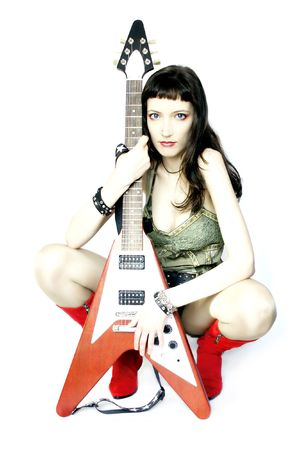 Urban Guitar Player (Girl With ''Flying V'' Guitar) Stock Photo - 591906