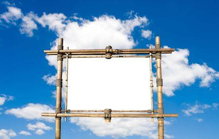 Blank Bamboo Billboard Over Blue Sky photo