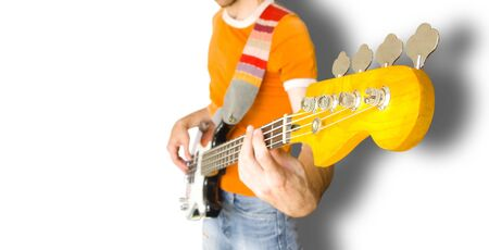 Bass Guitar Player Over White Background (with clipping path for easy background removing if needed) photo