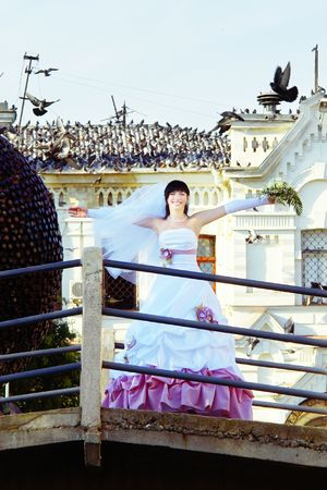 Happy Young Bride (With Flying Doves On The Background) photo