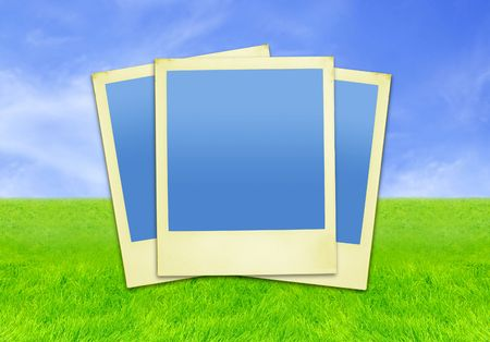 Photo Frames Against Skyandamp,amp,Grass Background (with clipping paths for easy framing your pictures if needed) photo
